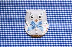 Background with  a honey-cake owl Stock Photos