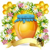 Background with honey jar Stock Photo