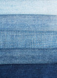 Background of horizontal stripes fabric blue jeans of different Stock Photos