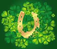 Background with horseshoe and clovers Royalty Free Stock Photos