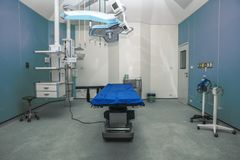 Hospital empty operation room with surgery bed and surgery light. Background of hospital empty operation room with surgery bed and surgery light stock image