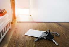 Background hotel room the morning warm atmosphere and a safety key that rests on a brown wooden desk.  stock photo