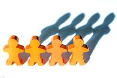 Background of a human chain of wooden figures on cohesion stock photo