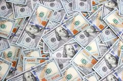 Background of hundred dollar bills of the new sample. The background of hundred dollar bills of the new sample Royalty Free Stock Photography
