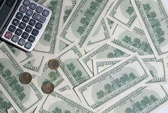 Background hundred dollars, coins and calculator Stock Photography