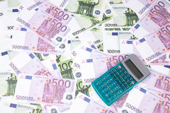 Background of hundreds euro and calculator Royalty Free Stock Photos