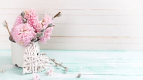 Background  with hyacinths,  willow flowers  in aged mug and dec Royalty Free Stock Images