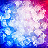 Background with ice cubes in blue light Royalty Free Stock Images