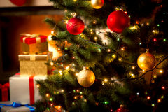 Background with illuminated fir tree and fireplace at house stock photos
