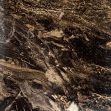 The background image of the artificial stone.Top view. The background image of the artificial stone.Texture of dark brown marble Royalty Free Stock Photo