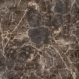 The background image of the artificial stone.Top view. The background image of the artificial stone.Texture of dark brown marble Royalty Free Stock Images