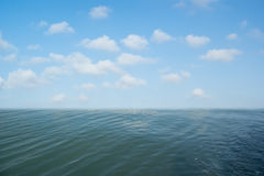 Background image of the blue sky and seas. The beautiful white clouds and blue sky Royalty Free Stock Photos