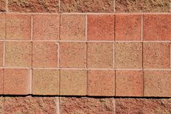 Background image of brick wall in the color of warm coral Royalty Free Stock Photo