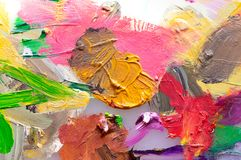 Background image of bright oil paint on the palette. Close-up, abstraction stock image