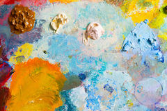 Background image of bright oil-paint palette. Closeup Royalty Free Stock Photos