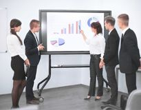 Business woman giving presentation to colleagues during meeting Royalty Free Stock Photo