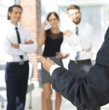 Background image of businessman holding out hand for a handshake. Royalty Free Stock Photos