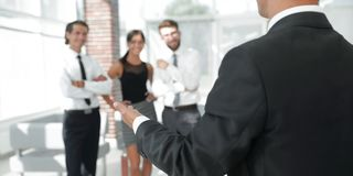 Background image of businessman holding out hand for a handshake. Business background Stock Photos