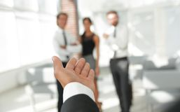Background image of businessman holding out hand for a handshake. Stock Photos