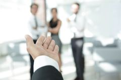 Background image of businessman holding out hand for a handshake. Royalty Free Stock Photo