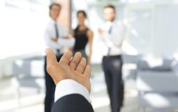 Background image of businessman holding out hand for a handshake. Business background Stock Image