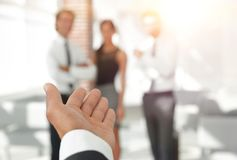 Background image of businessman holding out hand for a handshake. Business background Stock Photography