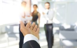 Background image of businessman holding out hand for a handshake. Business background Stock Photo