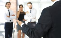 Background image of businessman holding out hand for a handshake. Business background Royalty Free Stock Photo