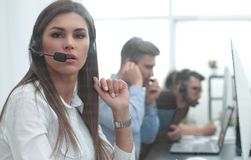 Call center employee in the workplace Stock Images