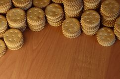 Background image of classic salty cracker on a brown wooden table with copyspac. E Royalty Free Stock Photography
