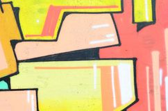 Fragment of an old wall with colorful graffiti painting royalty free stock images