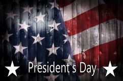 President s Day background on wood. A background image featuring an American flag on wood with the text President s Day and copy space stock image