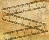 Background image with filmstrip. Background image with interesting texture old paper and filmstrip Royalty Free Stock Image