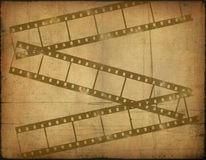 Background image with filmstrip. Background image with interesting texture old paper and filmstrip Stock Photos
