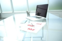Background image is a financial chart and a pen on the table royalty free stock photography
