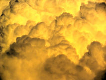 Stormy clouds background. A background image of fluffy orange and dark clouds, hovering over just before sunset on a stormy day near a desert. The photo is an Royalty Free Stock Photos