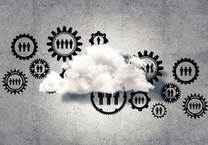 Wireless technologies for connection and sharing data as abstrac. Background image with gears and cloud computing connection concept on concrete wall Stock Photo