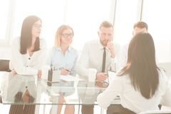 Background image of a group of business people sitting at a Desk. Photo with copy space royalty free stock photos