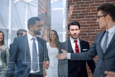 Background image of a group of business people standing in the office. Business background stock images