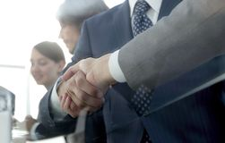 Handshake of business partners in conference room Stock Photo