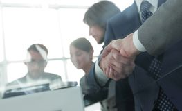 Handshake of business partners in conference room royalty free stock images