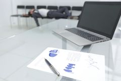 Background image of a laptop on a glass table in an empty office stock images