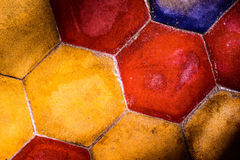 The background image of old colorful hexagonal clay tiles Stock Photos