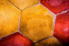 The background image of old colorful hexagonal clay tiles Royalty Free Stock Photo