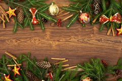 Christmas tree branches with red bows on a brown wooden background stock photos