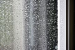 Background image of rain drops on a glass window. Macro photo with shallow depth of fiel. D Stock Photos
