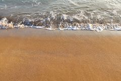 Background image of sandy beach and ocean waves.  stock photos