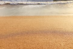 Background image of sandy beach and ocean waves.  stock photography