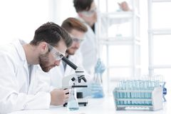 Background image scientists working with the microscope. Photo with copy space Stock Image