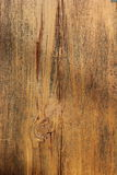 Background Image Shows Wood Grain of Old Barn Wood. Image shows wood grain, paint residue, and cracking on old barn wood Stock Photo
